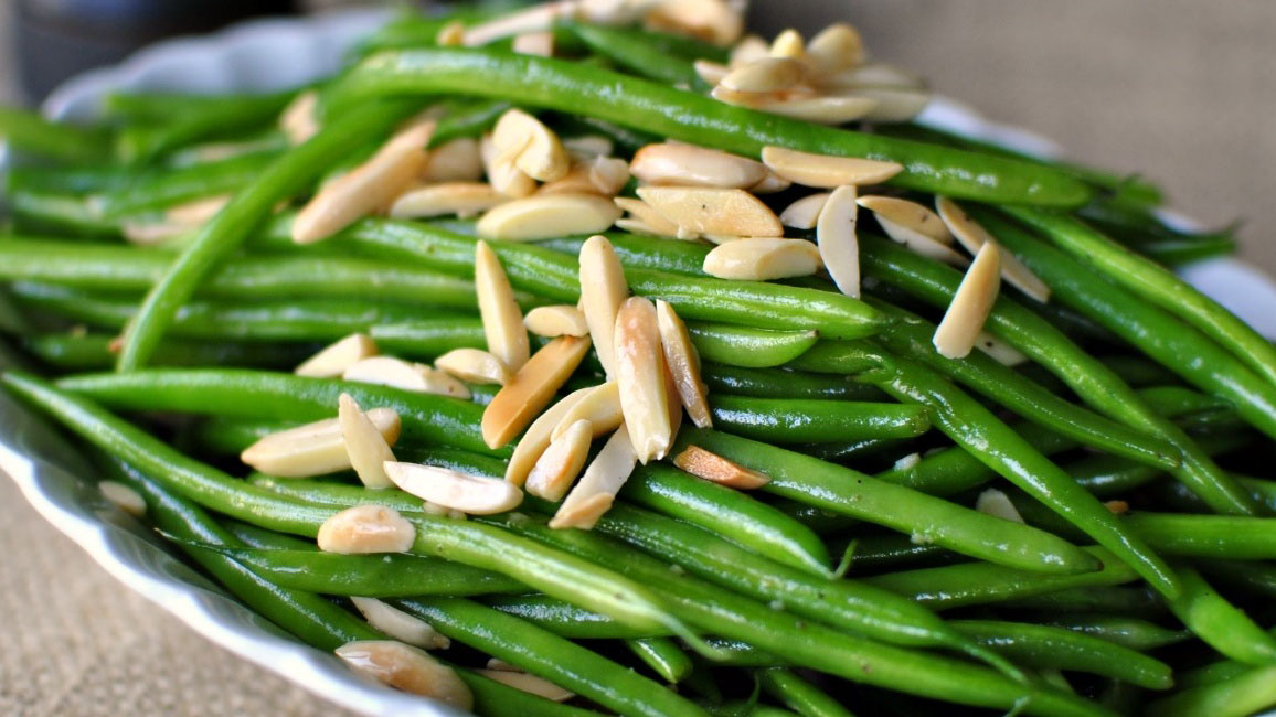https://www.smokingchimney.com/recipe-pages/images/16x9/green-beans-with-silvered-almonds.jpg